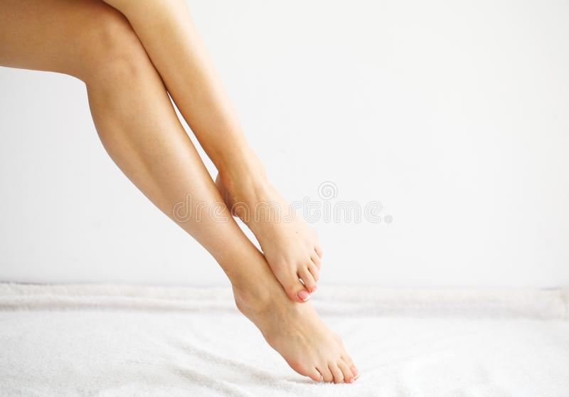 Hair Removal. Close Up Woman Hands Touching Long Legs, Soft Skin.  royalty free stock photo
