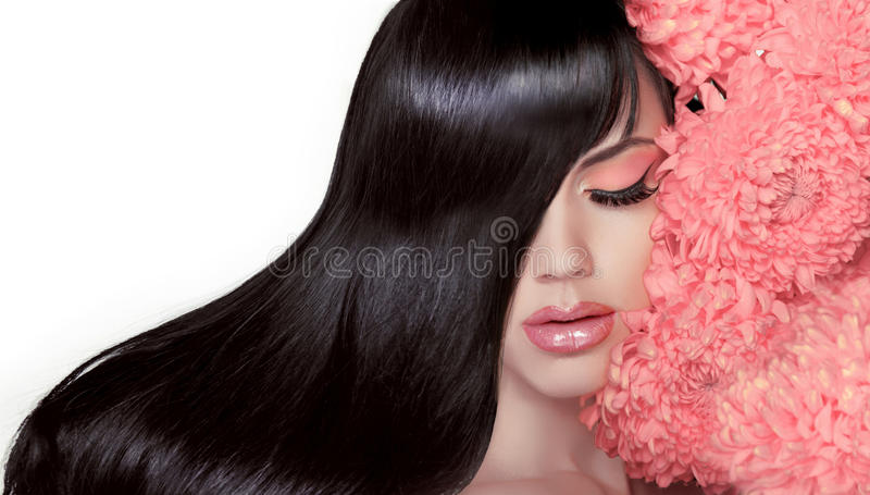 Hair Salon. Beauty Woman with Long Healthy and Shiny Smooth Black Hair. Model Brunette Girl Portrait isolated on a white royalty free stock images