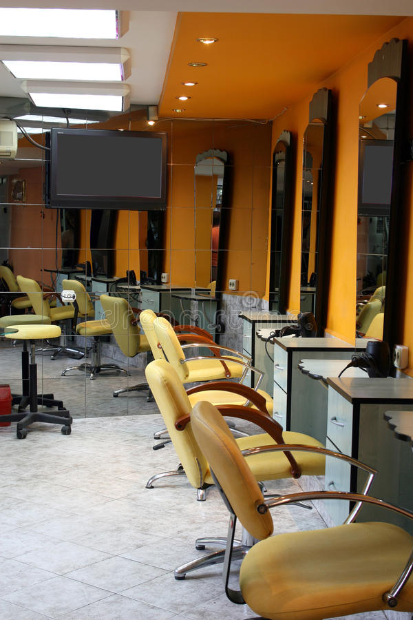Hair saloon. Modern empty hair saloon with chairs and mirrors royalty free stock photo