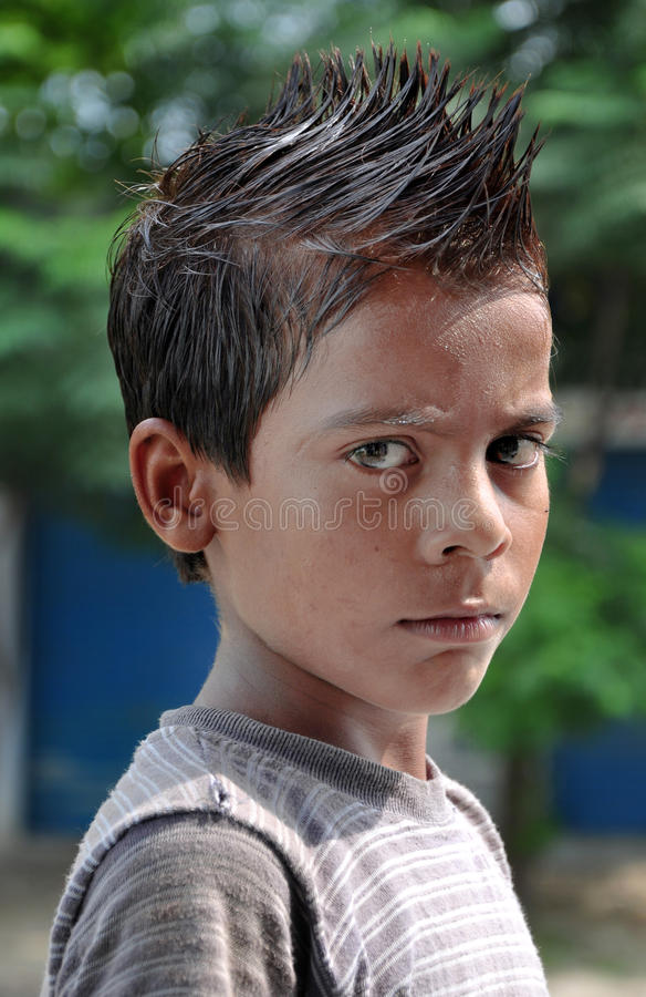 Hair spikes. Indian boy with hair spikes stock images
