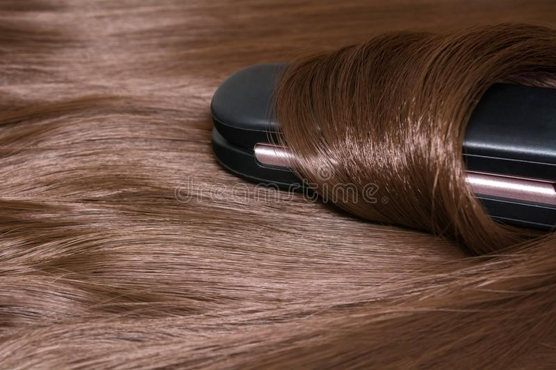 Hair straightener. Brilliant smooth beautiful hair and hair curler.  stock image