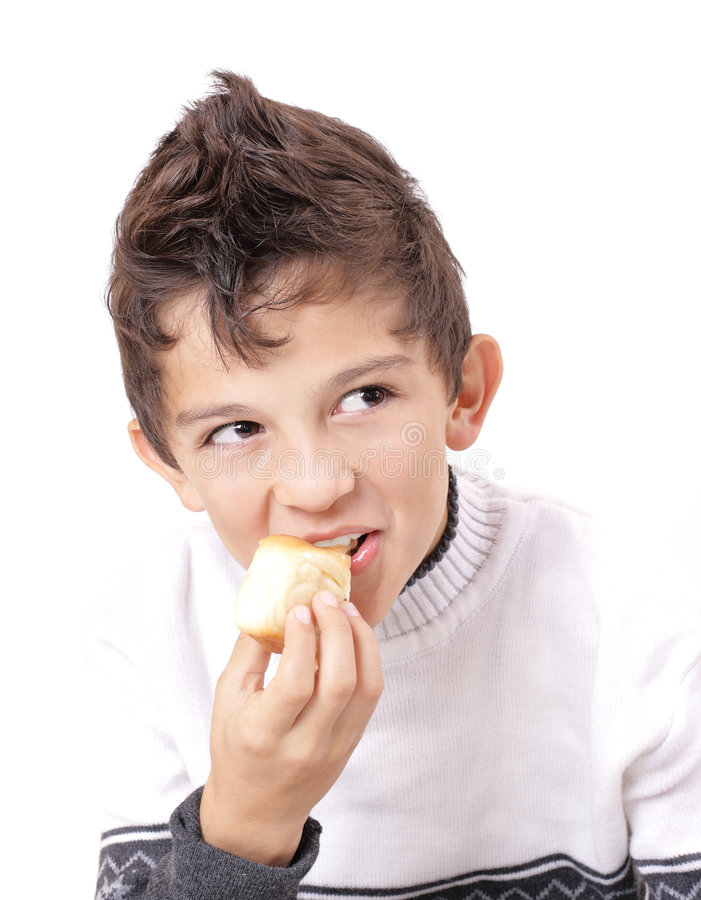Hair style. Rollicking boys with cake in hand royalty free stock photo