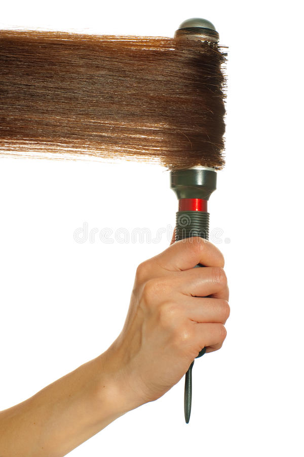 Hair styling. With round hairbrush isolated on white background royalty free stock photos