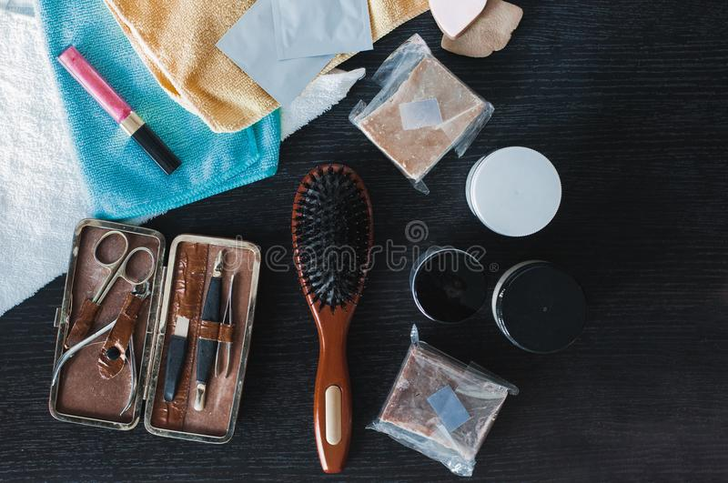 Hair styling and care background. Hair and nail beauty products royalty free stock photography