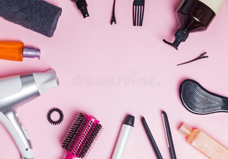 Hair styling and care items and products on pink background stock image