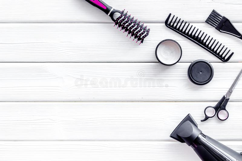 Combs, sciccors and pink hairdresser tools in beauty salon work desk on white wooden background top view mockup. Hair styling concept. Combs, sciccors and pink royalty free stock photo