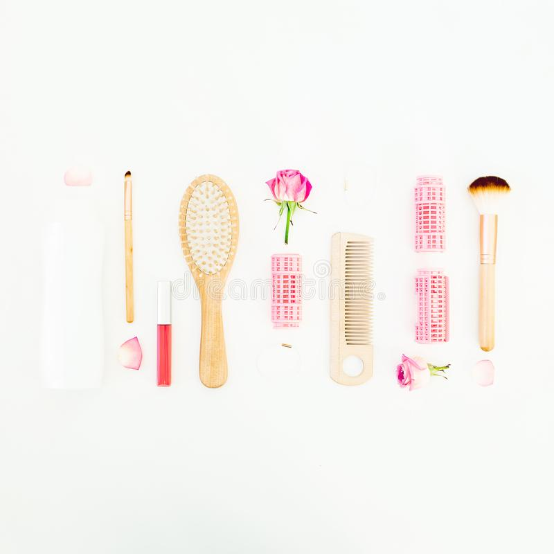 Hair styling concept with tools, curlers and shampoo on white background. Beauty composition. Flat lay, top view. Hair styling concept with tools, curlers and royalty free stock photo