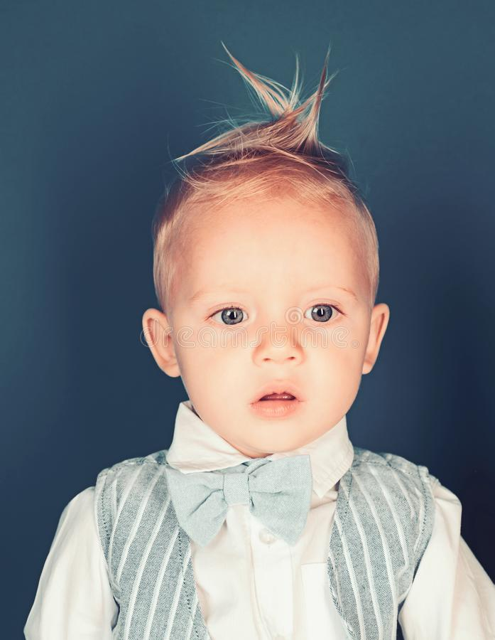 Hair styling products. Small boy with stylish haircut. Boy child with stylish blond hair. Small child with messy top royalty free stock images