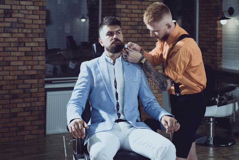 Hair Stylist and Barber. Hair salon and barber vintage. Brutal guy in modern Barber Shop. Trims. Great time at royalty free stock photos