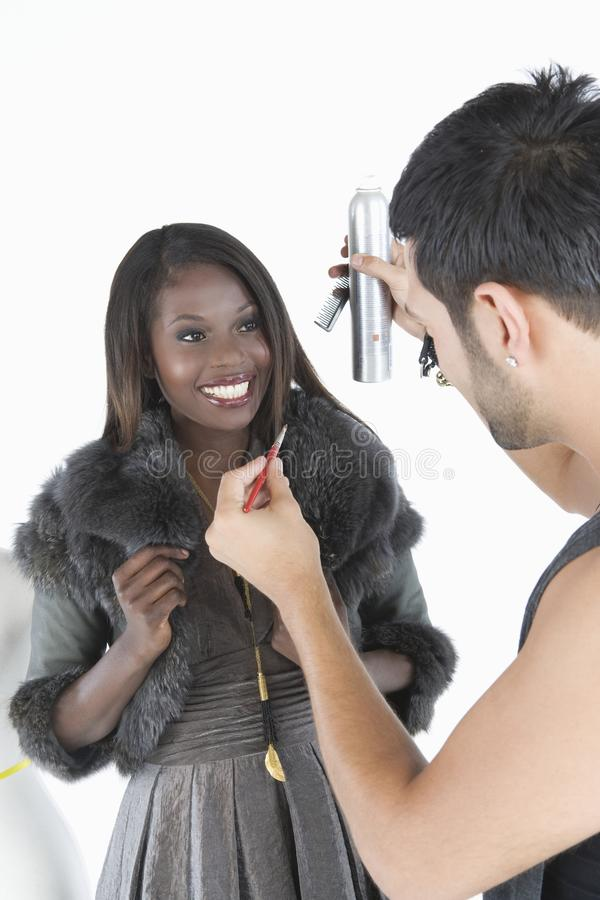 Free Hair Stylist Makes Adjustments To Model In Fur Jacket Stock Photo - 29666220