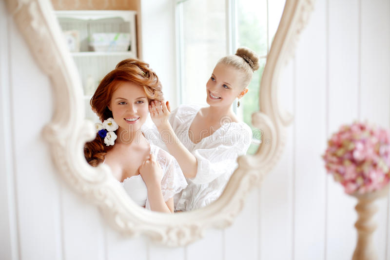 Hair stylist makes the bride before the wedding royalty free stock image