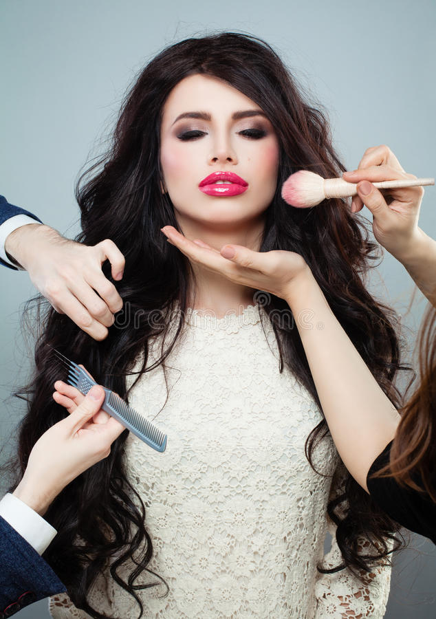 Hair Stylist and Makeup Artist doing Make up and Hairstyle stock photo