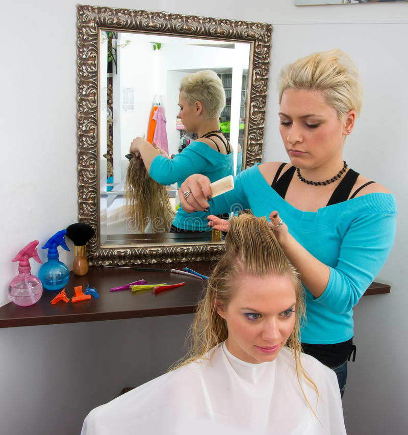 Hair stylist at work stock image