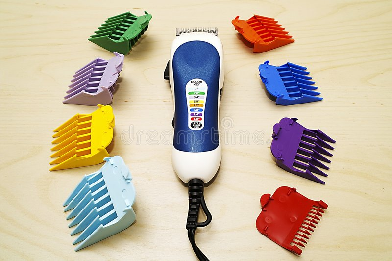 Hair Trimmer Set. A full set hair trimmer with rulers royalty free stock image