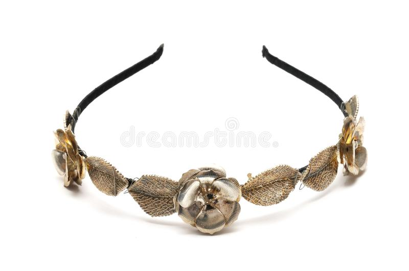 A hairband with metal flowers and leaves decoration stock photo