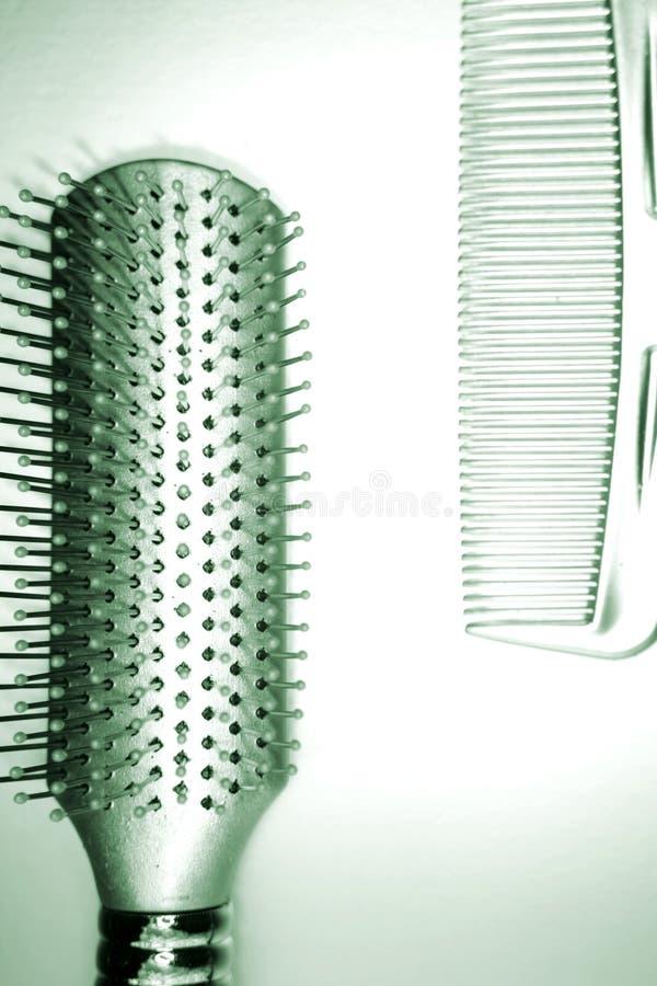 hairbrush e pettine fotografia stock