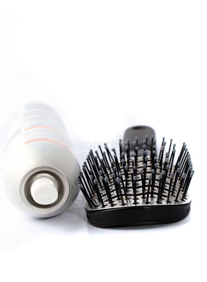 Hairbrush und Haarspray stockbild