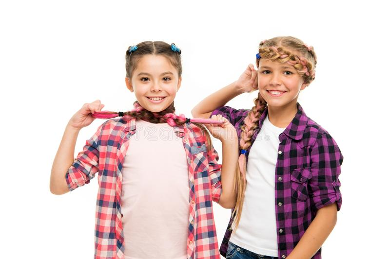 Haircare begins with natural products. Happy children hold long hair braids. Haircare and hairstyling. Develop healthy royalty free stock photography