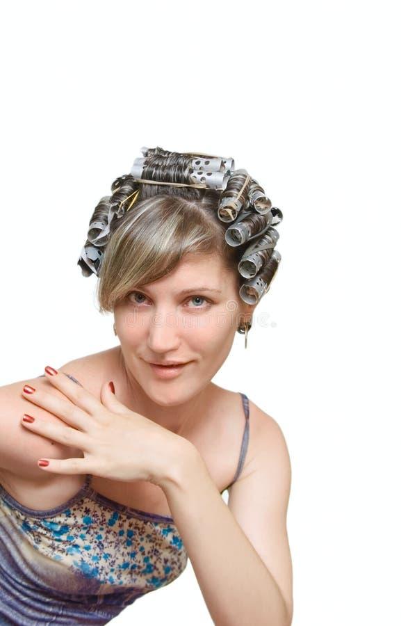 haircurlers继承人她的妇女年轻人 库存照片