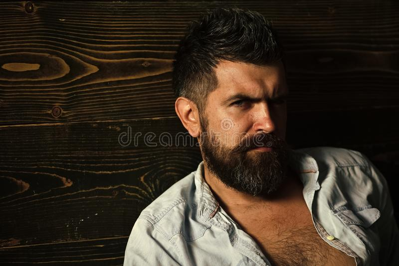 Haircut of bearded man, archaism. Barber and hairdresser salon. Fashion and male beauty of graying man. Man with beard. And mustache on wooden background royalty free stock images