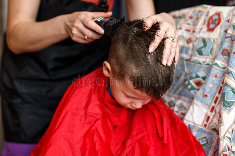 Haircut for boy at home with machine. Haircut for 3 years old boy at home with machine stock image