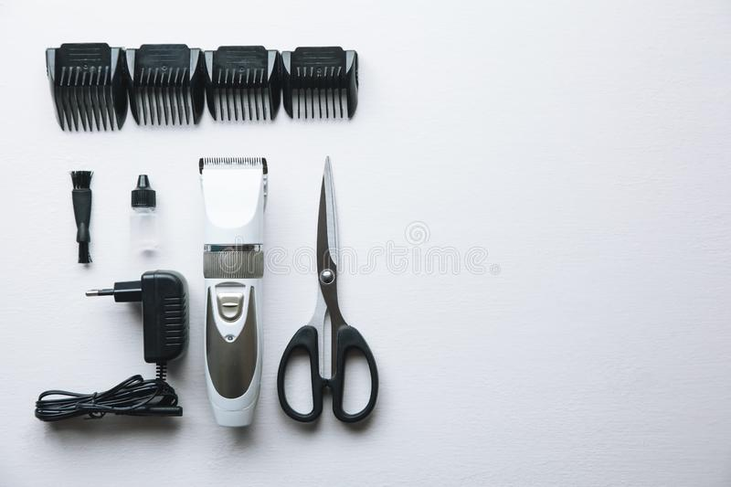 Haircut machine and clippers on white background. royalty free stock photography