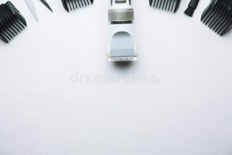 Haircut machine and clippers on white background. royalty free stock image