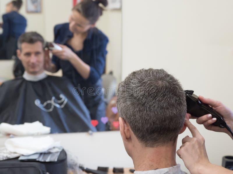 Haircut machine. Man clipping machine in salon. Haircut machine. Man clipping machine in the beauty salon stock photography