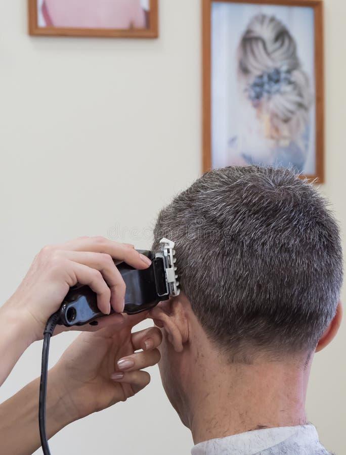 Haircut machine. Man clipping machine in salon. Haircut machine. Man clipping machine in the beauty salon royalty free stock photos
