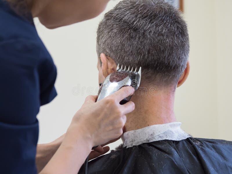 Haircut machine. Man clipping machine in salon. Haircut machine. Man clipping machine in the beauty salon royalty free stock image