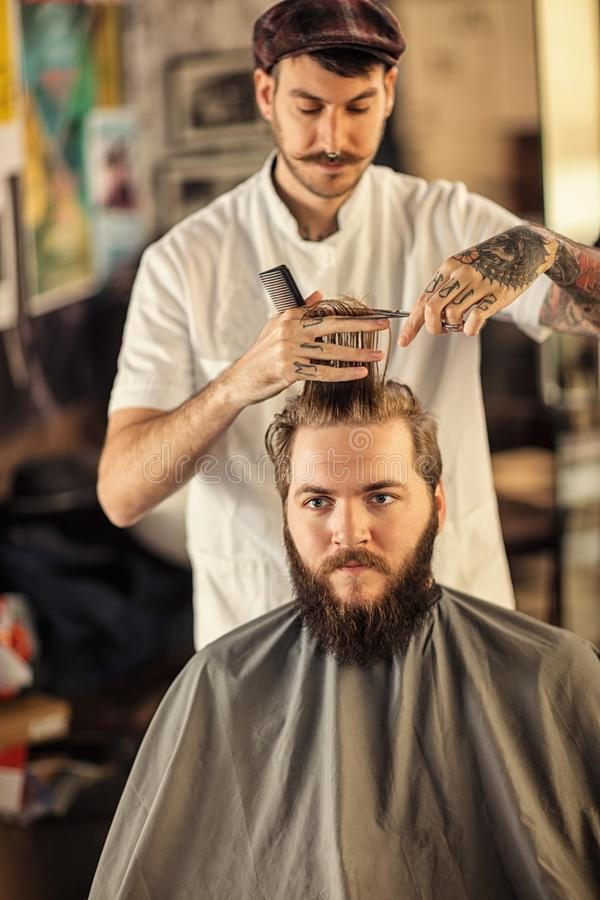 Haircut by a professional barber royalty free stock photography