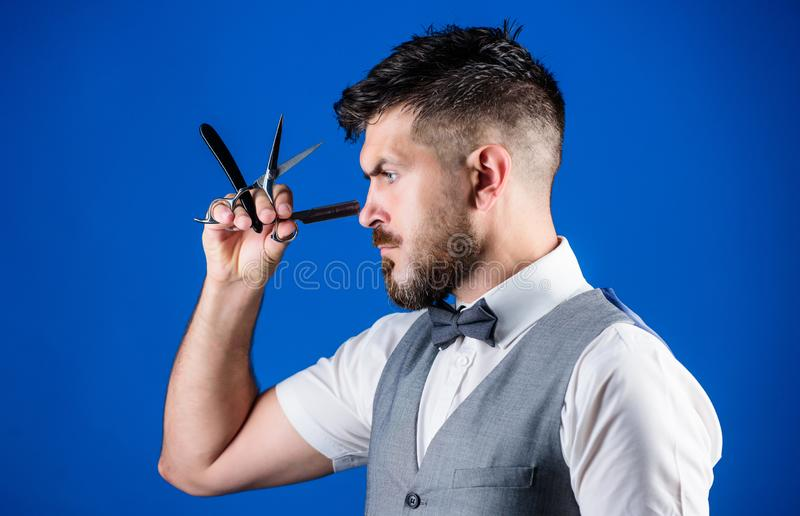 Haircuts and shaves. Bearded man with razor and scissors in retro barbershop. Hipster with beard in razor barber shop royalty free stock photos