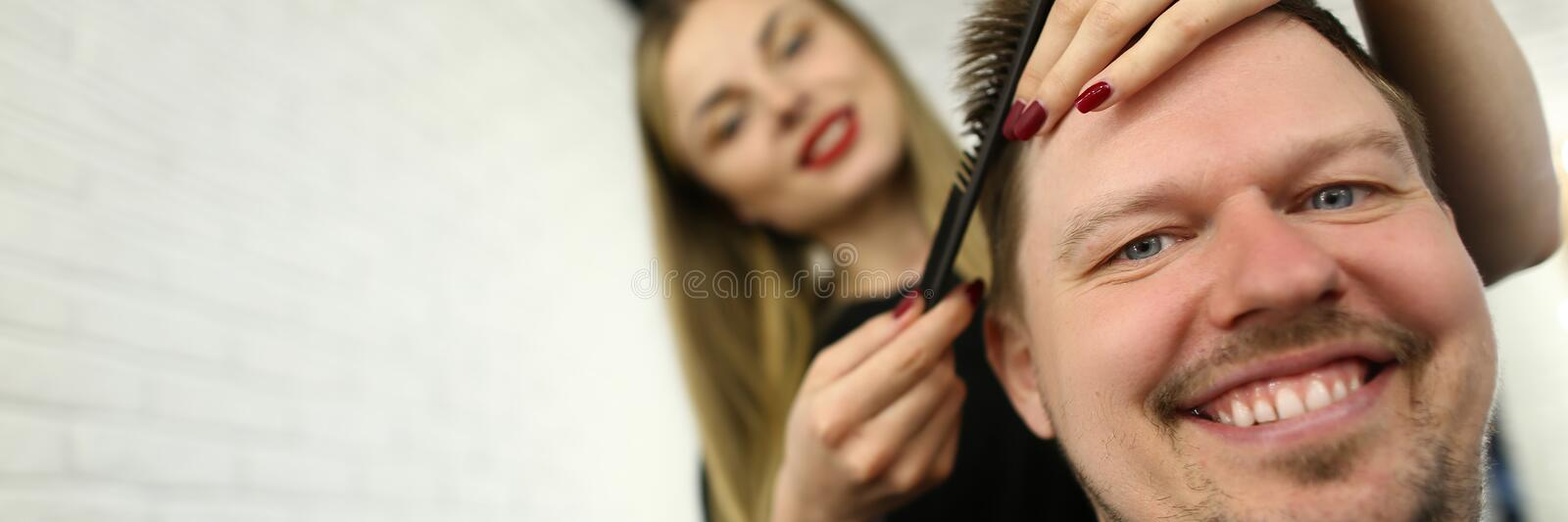 Hairdresser Combing Male Hair in Beauty Salon royalty free stock photo