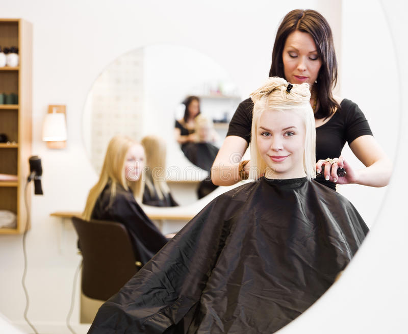 Hairdresser and customer royalty free stock photos