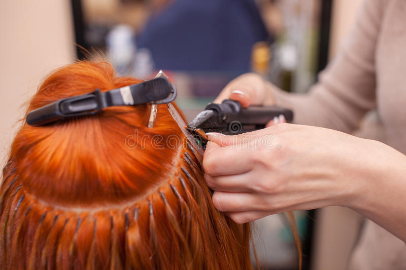 The hairdresser does hair extensions to a young red haired girl download the hairdresser does hair extensions to a young red haired girl in pmusecretfo Image collections