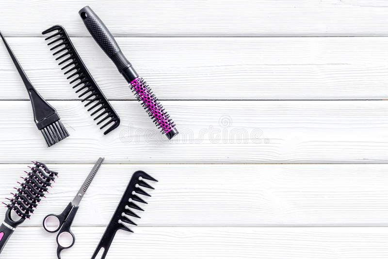 Hairdresser equipment for cutting hair and styling with combs, sciccors on white wooden background top view copyspace stock photos