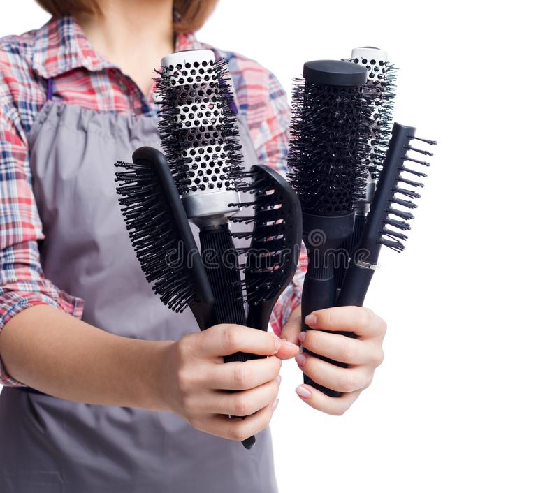 Hairdresser holding various combs or hairbrushes royalty free stock photo