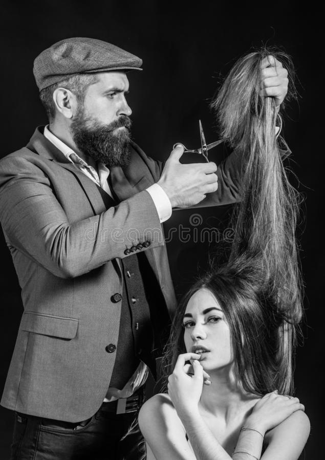 Hairdresser make fashion hairstail. Beautiful model with very long hair. Hairdresser, beauty salon. Black and white stock image