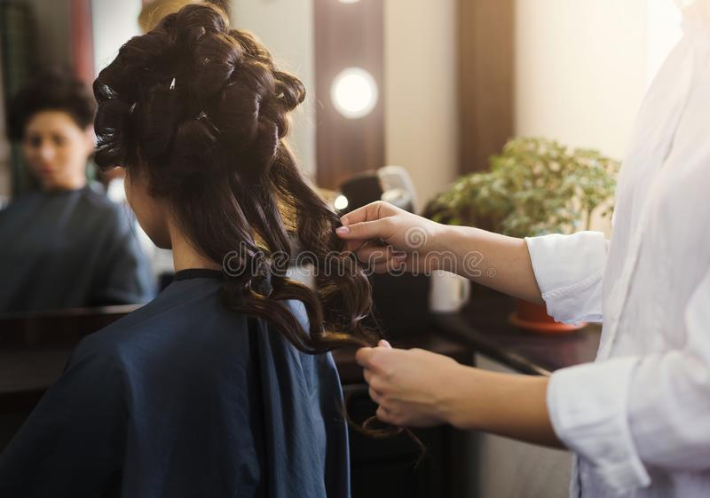 Hairdresser making wave hair to client royalty free stock photos