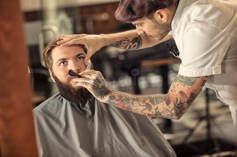 Hairdresser with old-fashioned black razor royalty free stock photos