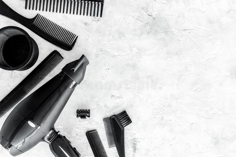 Hairdresser work desk with tools for hair styling on gray stone background top view space for text. Hairdresser professional work desk with tools for hair royalty free stock photo