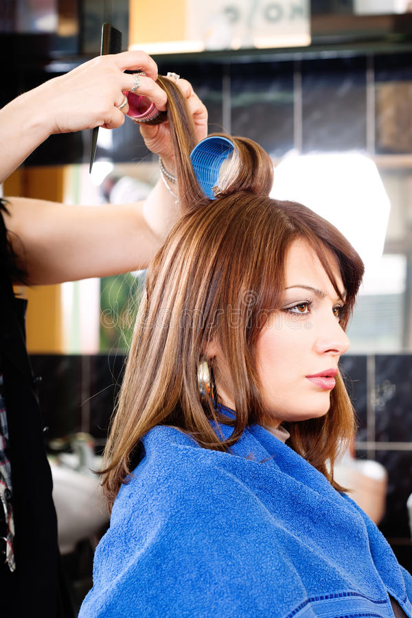 Download Hairdresser Putting Rollers On Hair Stock Photo - Image of girl, comb: 23632738