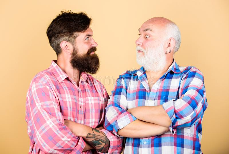 Hairdresser salon. Barber well groomed handsome mature man. Brutality and masculinity. Bearded friends. Father and son stock photography
