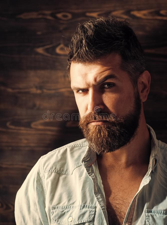 Hairdresser salon. Fashion and male beauty of graying man. Barber and hairdresser salon. Man with beard and mustache on. Wooden background stock photos