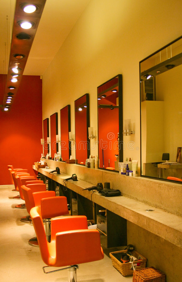 Hairdresser saloon. Modern red interior of hair dresser saloon royalty free stock photography