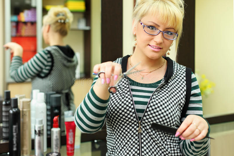 Download Hairdresser With Scissors And Comb In Workplace Stock Photo - Image: 25096422