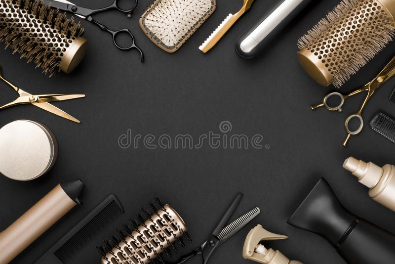 Hairdresser tools on black background with copy space in center royalty free stock photo