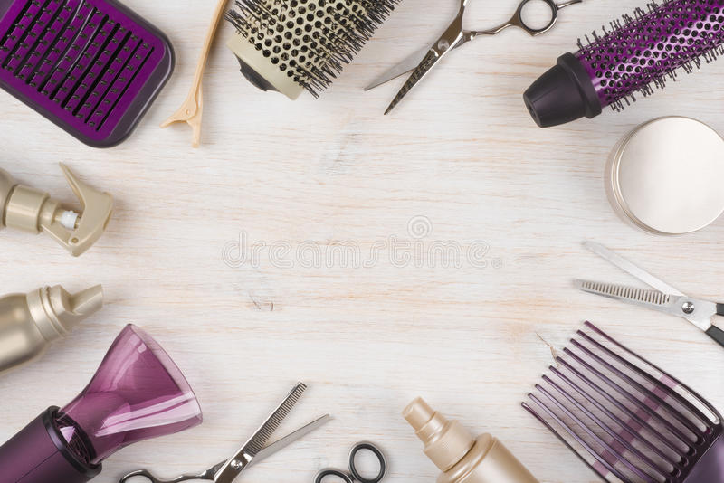 Hairdresser tools on wooden background with copy space in center royalty free stock photography