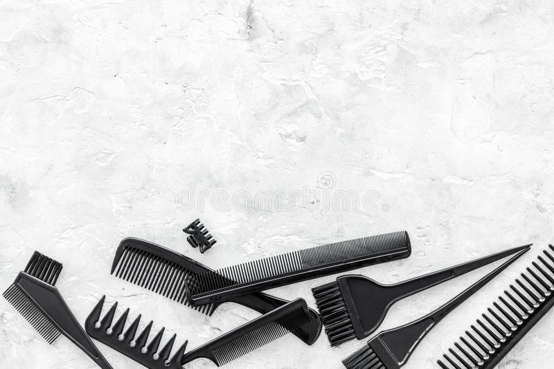 Hairdresser work desk with tools for hair styling on gray stone background top view space for text. Hairdresser professional work desk with tools for hair stock image