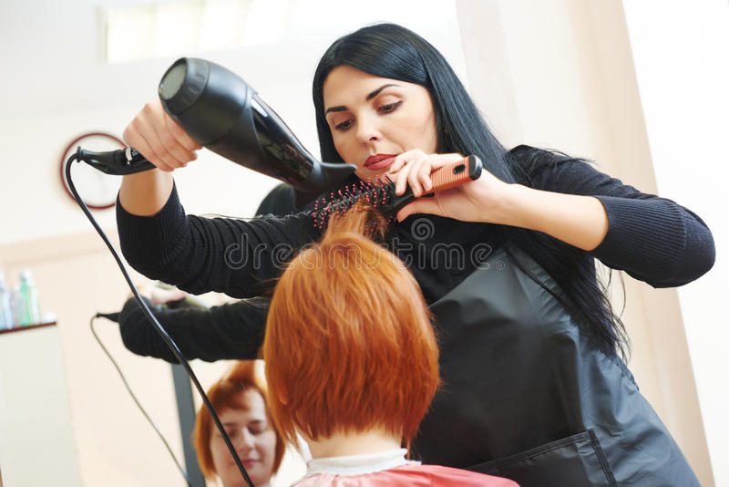 Hairdresser at work. Drying hair royalty free stock photo